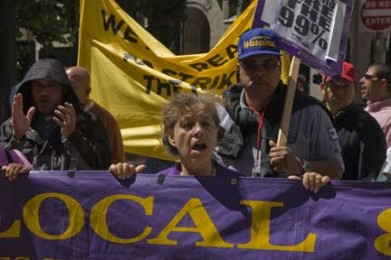 Janitors March and Threaten to Strike