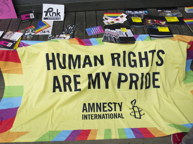 EuroPride took place in Riga, Latvia on 20th June 2015. Over 5,000 people from across the world attended. Latvia is the first former Soviet country to host the event.   The parade was heavily policed with only a small number of counter protestors. Amnesty International sent a large delegation to the event.  Shows the Amnesty International banner - human rights are my pride.