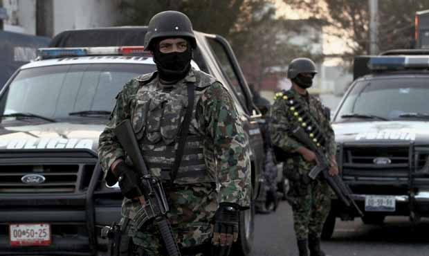 "Mexican marines stand guard in front of the inter-municipal police station during the operation ""Veracruz Safe"" in Boca del R?o, Veracruz State, Mexico on 21 December 2011. More than 40,000 people have been killed in rising drug-related violence in Mexico since December 2006, when President Felipe Calderon deployed soldiers and federal police to take on organized crime. AFP PHOTO/Lucas Castro (Photo credit should read LUCAS CASTRO/AFP/Getty Images)"