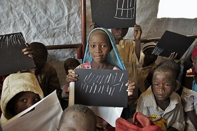 THIS ASSET IS EMBARGO until 00.01am GMT 22 December 2015: On 3 December 2015, a young girl proudly shows her calculus exercise results. She is one of the 164 displaced children from Niger who attends the recently constructed classrooms of Assaga refugee camp. The camp of Assaga sheltering 2.608 refugees and 3.771 displaced from the conflict in Northern Nigeria. Assaga camp is located at 14 km from Diffa, Eastern Niger, and two classrooms opened their doors to 164 children on 2 Decembre 2015. UNICEF supports the Regional Directorate of Education as well as implementing partners to make sure that children continue to have access to education during these troubled times.  Under embargo until 00.01am GMT 22 December 2015.