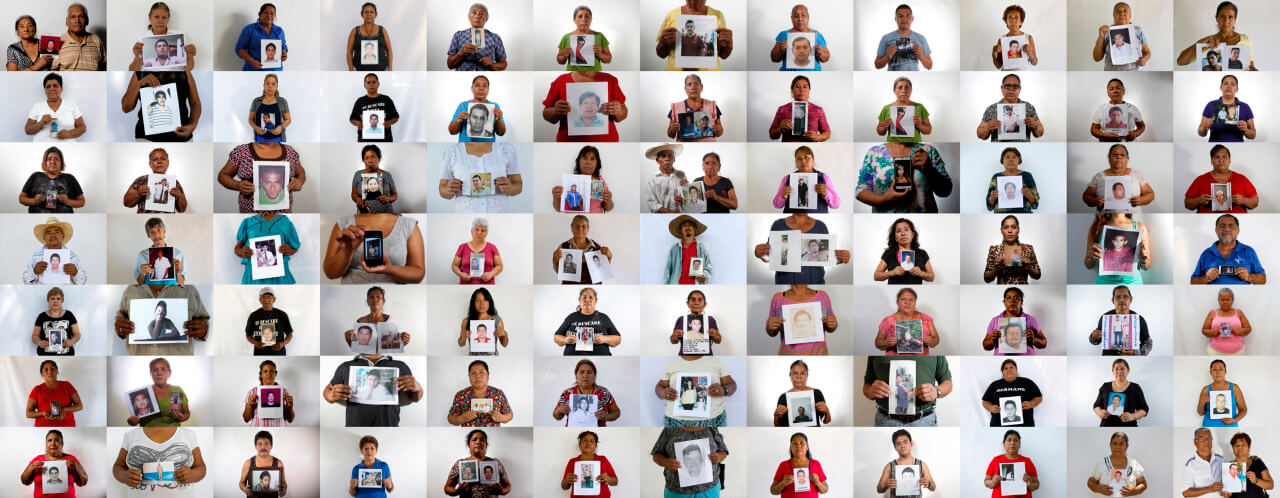 """This is an 84 photo composite of people holding an image of their missing relative shot between April and August, 2015 in the city of Iguala and surrounding towns. The world, and even most of Mexico, paid little attention to Iguala until 43 students from a rural teachers college disappeared on Sept. 26, 2014. The government's investigation concluded that police in Iguala turned over the students to members of a drug gang who then killed them and incinerated their remains at a garbage dump. Two months after the students disappeared many other families in the area began coming forward to tell their stories, emboldened by the international attention focused on the missing students. Their message was simple: there are many more missing. They called them """"the other disappeared."""" To tell the stories of those other disappeared and the gaping wounds that their kidnappings left behind the AP interviewed the relatives of 147 (check latest figure) of those missing.  Only 84 agreed to be photographed because they are still very fearful. Of those disappearances discussed with families, all but 10 occurred between 2010 and 2015 and all but eight were in the state of Guerrero. Men or boys accounted for all but 14 of the cases. The missing ranged in age from 13 to 60 years old with the majority being in their 20s and 30s. Eighty percent were younger than 40. Since the government began excavating suspected graves found by families scouring the surrounding mountains looking for their loved ones late last year, more than 100 bodies have been exhumed though most still await identification. (AP Photo/Dario Lopez-Mills)"""