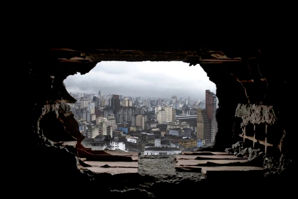 View from a hole in the staircase on the 15th floor  inside of the Prestes Maia 911 occupation in Sao Paulo, looking out to central Sao Paulo. The Prestes Maia 911 was occupied by more than 400 families for over 4 years.