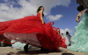 """Young women dressed as Quinceaneras perform and protest SB4, an anti-""""sanctuary cities"""" bill, at the Texas Capitol in Austin, Texas, Wednesday, July 19, 2017. The """"sanctuary cities"""" ban, signed in May, lets police ask people during routine stops whether they're in the U.S. legally. (AP Photo/Eric Gay)"""