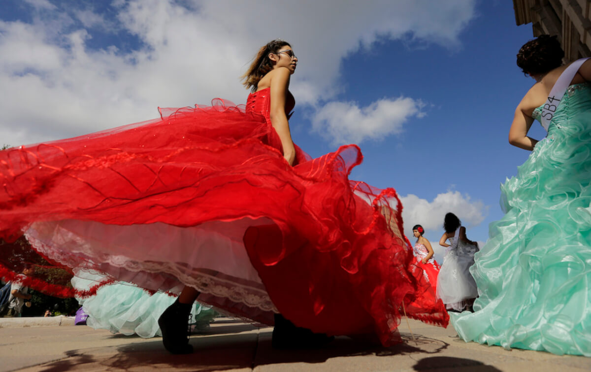 "Young women dressed as Quinceaneras perform and protest SB4, an anti-""sanctuary cities"" bill, at the Texas Capitol in Austin, Texas, Wednesday, July 19, 2017. The ""sanctuary cities"" ban, signed in May, lets police ask people during routine stops whether they're in the U.S. legally. (AP Photo/Eric Gay)"