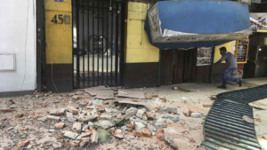 A man enters to a damage building damaged  after a earthquake in Mexico City, Tuesday, Jan. 19, 2017. A powerful earthquake has jolted Mexico, causing buildings to sway sickeningly in the capital on the anniversary of a 1985 quake that did major damage. (AP Photo/Eduardo Verdugo)