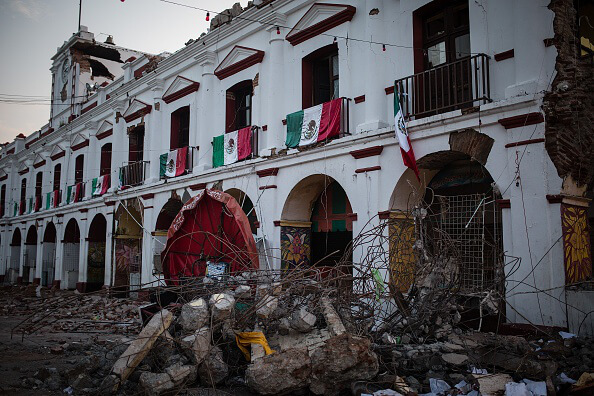 JUCHITAN, MEXICO - SEPTEMBER 09: A damaged building is seen in the aftermath of the earthquake at a damaged site in Juchitan, Mexico on September 09, 2017. An earthquake with magnitude of 8.2 and epicenter in the state of Chiapas, hit the south of Mexico. (Photo by Manuel Velasquez/Anadolu Agency/Getty Images)