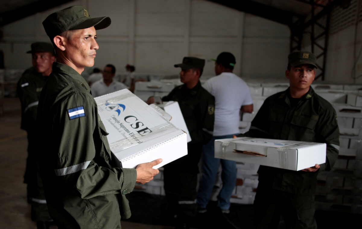 Members of Nicaragua's army carry ballot boxes at a distribution centre at the Supreme Electoral Council (CSE) in Managua, Nicaragua October 24, 2017. REUTERS/Oswaldo Rivas
